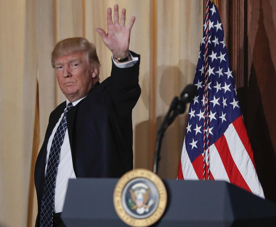 President Donald Trump waves as he walks off stage after signing an Energy Independence Executive Order, Tuesday, March 28, 2017, at EPA headquarters in Washington, Tuesday, March 28, 2017. (AP Photo/Pablo Martinez Monsivais)