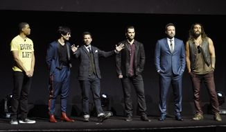 "Zack Snyder, center, director of the upcoming film ""Justice League,"" addresses the audience with cast members, from left, Ray Fisher, Ezra Miller, Henry Cavill, Ben Affleck and Jason Momoa during the Warner Bros. Pictures presentation at CinemaCon 2017 at Caesars Palace on Wednesday, March 29, 2017, in Las Vegas. (Photo by Chris Pizzello/Invision/AP)"