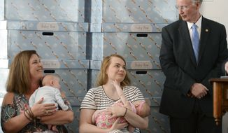 Alabama Gov. Robert Bentley talks with new mothers while launching a statewide Baby Box Program to help improve family healthcare outcomes and reduce Sudden Unexpected Infant Death Syndrome (SUIDS) Wednesday, March 29, 2017, at the Capitol in Montgomery, Ala. (Julie Bennett /AL.com via AP)