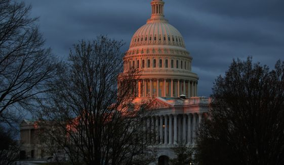 The Capitol is illuminated by the rising sun in Washington, Wednesday, March 29, 2017. (AP Photo/J. Scott Applewhite)