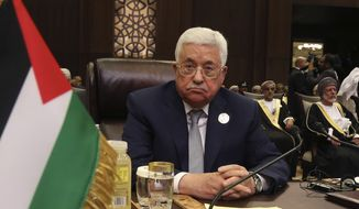 Palestinian President Mahmoud Abbas attends the summit of the Arab League at the Dead Sea, Jordan, Wednesday, March 29, 2017. Arab leaders are gathering for an annual summit where the long-stalled quest for Palestinian statehood is to take center stage. The summit is expected to endorse key Palestinian positions, signaling to President Donald Trump ahead of White House meetings with leaders of Egypt and Jordan that a deal on Palestinian statehood must precede any Israeli-Arab normalization. (AP Photo/ Raad Adayleh)