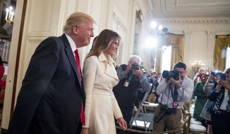 President Donald Trump and first lady Melania Trump arrive for a women's empowerment panel, Wednesday, March 29, 2017, in the East Room of the White House in Washington. (AP Photo/Andrew Harnik) ** FILE **