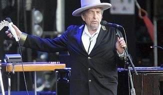 "FILE - This July 22, 2012 file photo shows U.S. singer-songwriter Bob Dylan performing on stage at ""Les Vieilles Charrues"" Festival in Carhaix, western France. The Bob Dylan Archive has opened in Oklahoma, more than a year after the announcement that more than 6,000 items spanning the music icon's six-decade career would be housed in Tulsa.(AP Photo/David Vincent, File)"