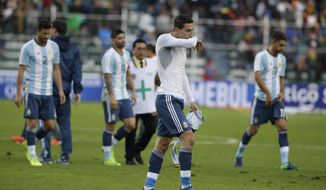 Argentina's angel Di Maria and teammates leave the pitch after their 0-2 lost against Bolivia in a 2018 World Cup soccer qualifying match in La Paz, Bolivia, on Tuesday, March 28, 2017. (AP Photo/Victor R. Caivano)