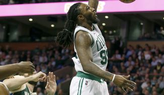 Boston Celtics forward Jae Crowder dunks the ball ahead of Milwaukee Bucks players during the first half of an NBA basketball game, Wednesday, March 29, 2017, in Boston. (AP Photo/Mary Schwalm)