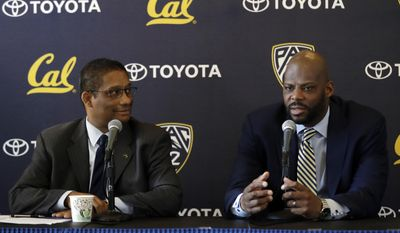 Wyking Jones, right, fields questions alongside athletic director Michael Williams during a press conference to announce Jones' appointment as California men's basketball coach Wednesday, March 29, 2017, in Berkeley, Calif. (AP Photo/Marcio Jose Sanchez)