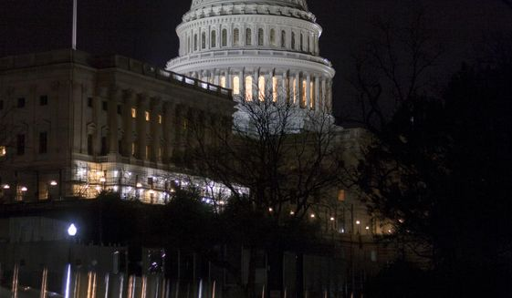 The illuminated Capitol Dome is reflected off the top of parked cars before dawn in Washington, Tuesday, March 28, 2017. (AP Photo/J. Scott Applewhite)
