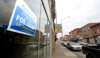 City of Dubuque officials have launched a new program to revitalize a downtrodden stretch of Central Avenue in Dubuque, Iowa, seen in a Tuesday March 28, 2017 photo.  (Dave Kettering/Telegraph Herald via AP)
