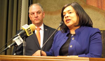 Gov. John Bel Edwards listens as his revenue secretary, Kimberly Robinson, answers questions about the Edwards administration tax package proposed for the upcoming legislative session, on Wednesday, March 29, 2017, in Baton Rouge, La. (AP Photo/Melinda Deslatte)