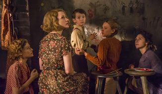 """In this image released by Focus Features, Efrat Dor, from left, Jessica Chastain, Timothy Radford, Shira Haas and Martha Issova appear in a scene from """"The Zookeeper's Wife."""" (Anne Marie Fox/Focus Features via AP)"""