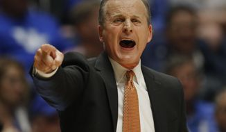 FILE - In this March 11, 2016, file photo, Tennessee head coach Rick Barnes directs his team against LSU during the first half of an NCAA college basketball game in the Southeastern Conference tournament in Nashville, Tenn. Tennessee is the first team since the 2004-05 Iowa squad to have faced every eventual Final Four team during the regular season. (AP Photo/John Bazemore, File)