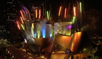 FILE - In this Thursday, Oct. 23, 2003, file photo, fireworks light the Walt Disney Concert Hall after Esa-Pekka Salonen conducted the Los Angeles Philharmonic in Los Angeles. The Getty Research Institute announced Wednesday, March 29, 2017, that it has acquired archives containing hundreds of thousands of sketches, drawings, models, photographs, slides and paperwork involving projects that Gehry designed between 1954 and 1988, including the famous Walt Disney Concert Hall. (AP Photo/Nam Y. Huh, File)