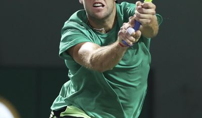 Jack Sock, of the United States, hits a backhand against Rafael Nadal, of Spain, during a quarterfinal match at the Miami Open tennis tournament, Wednesday, March 29, 2017, in Key Biscayne, Fla. (AP Photo/Mario Houben)