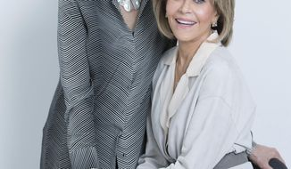 "In this March 24, 2017 photo, Lily Tomlin, left, and Jane Fonda, co-stars in ""Grace and Frankie,"" pose for a portrait in New York. The third season of the comedy series is currently streaming on Netflix. (Photo by Amy Sussman/Invision/AP)"