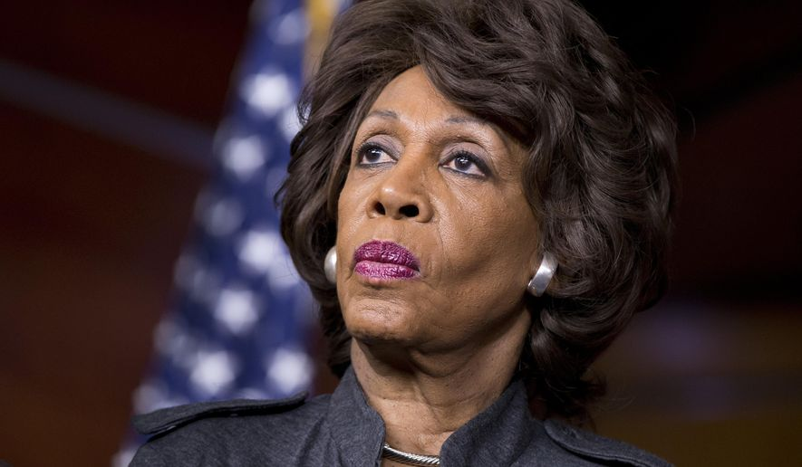 Rep. Maxine Waters, D-Calif., listens during a news conference on Capitol in Washington, in this Feb. 28, 2013, file photo. (AP Photo/J. Scott Applewhite, File)