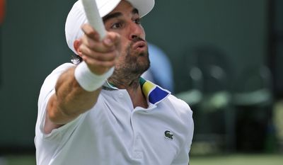 Jeremy Chardy, of France, returns a shot from Marin Cilic, of Croatia, at the Miami Open, Friday, March 24, 2017 in Key Biscayne, Fla. (AP Photo/Wilfredo Lee)