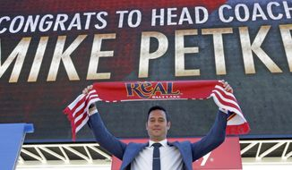 Real Salt Lake head coach Mike Petke poses for photographers after being announced as the MLS soccer club's new head coach during a news conference Wednesday, March 29, 2017, in Sandy, Utah. (AP Photo/Rick Bowmer)