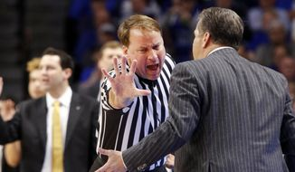 FILE - In this Feb. 28, 2017, file photo, Kentucky head coach John Calipari, right, address official John Higgins after being assessed a technical foul during the second half of an NCAA college basketball game against Vanderbilt, in Lexington, Ky. Referee John Higgins of Omaha has contacted law enforcement to report he's received death threats after Kentucky's loss to North Carolina in the NCAA South Regional final.A person with knowledge of the situation told The Associated Press that Higgins reported threats on his home phone, which has an unlisted number, and on the office phone for his roofing company. The person requested anonymity because the investigation is ongoing. (AP Photo/James Crisp, File) **FILE**
