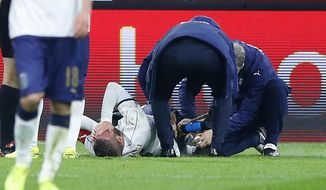 Italy's Daniele De Rossi puts hands on his face injured during the international friendly soccer match between The Netherlands and Italy at the Amsterdam ArenA stadium, Netherlands, Tuesday, March 28, 2017. (AP Photo/Peter Dejong)