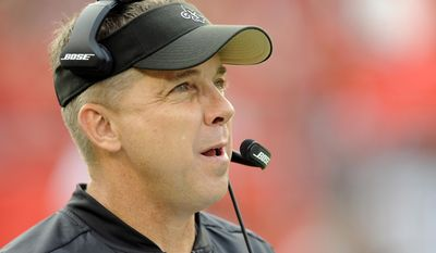 "FILE - In this Dec. 11, 2016, file photo, New Orleans Saints head coach Sean Payton watches during the first quarter of an NFL football game against the Tampa Bay Buccaneers in Tampa, Fla. Payton shot down a report that his New Orleans Saints had interest in troubled quarterback Johnny Manziel. They did meet during Super Bowl week, but Payton called the report the team was considering adding Manziel ""false.""  (AP Photo/Steve Nesius, File)"