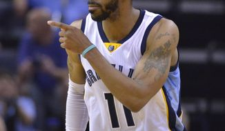 Memphis Grizzlies guard Mike Conley (11) reacts after scoring in the first half of an NBA basketball game against the Indiana Pacers Wednesday, March 29, 2017, in Memphis, Tenn. (AP Photo/Brandon Dill)
