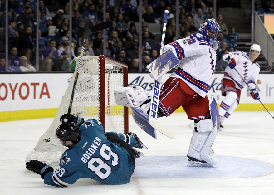 San Jose Sharks' Mikkel Boedker (89) collides with New York Rangers goalie Henrik Lundqvist during the second period of an NHL hockey game Tuesday, March 28, 2017, in San Jose, Calif. (AP Photo/Marcio Jose Sanchez)
