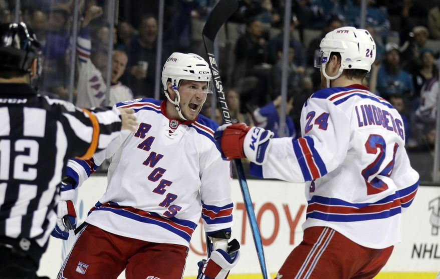 New York Rangers' J.T. Miller, left, celebrates his goal with teammate Oscar Lindberg (24) during the first period of an NHL hockey game against the San Jose Sharks on Tuesday, March 28, 2017, in San Jose, Calif. (AP Photo/Marcio Jose Sanchez)