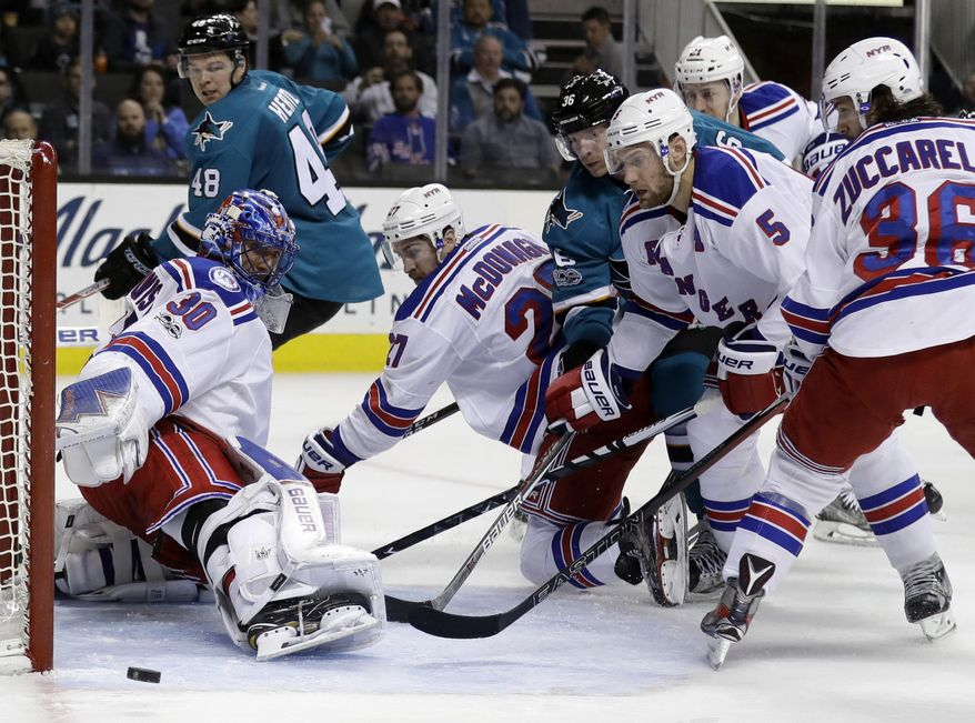 New York Rangers goalie Henrik Lundqvist (30) deflects a shot against the San Jose Sharks during the second period of an NHL hockey game Tuesday, March 28, 2017, in San Jose, Calif. (AP Photo/Marcio Jose Sanchez)