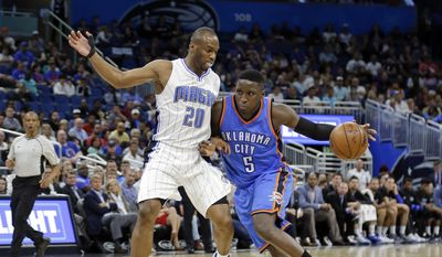 Oklahoma City Thunder's Victor Oladipo (5) drives around Orlando Magic's Jodie Meeks (20) during the first half of an NBA basketball game, Wednesday, March 29, 2017, in Orlando, Fla. (AP Photo/John Raoux)