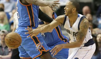 Dallas Mavericks guard Devin Harris (34) passes the ball against Oklahoma City Thunder guard Victor Oladipo (5) during the first half of an NBA basketball game in Dallas, Monday, March 27, 2017. (AP Photo/LM Otero)