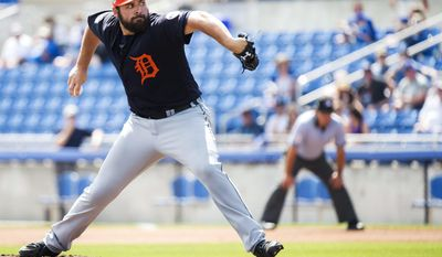 """FILE - In this March 1, 2017, file photo, Detroit Tigers starting pitcher Michael Fulmer works against the Toronto Blue Jays during the first inning of a spring training baseball game in Dunedin, Fla. Tigers manager Brad Ausmus has no illusions about what 2016 AL Rookie of the Year Michael Fulmer will be facing this season.""""He's got a target on his back,"""" Ausmus said. """"People know who he is. He's not sneaking up on anybody."""" (Nathan Denette/The Canadian Press via AP)"""