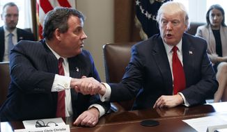 President Donald Trump shakes hands with New Jersey Gov. Chris Christie during an opioid and drug abuse listening sessionWednesday, March 29, 2017, in the Cabinet Room of the White House in Washington. (AP Photo/Evan Vucci)