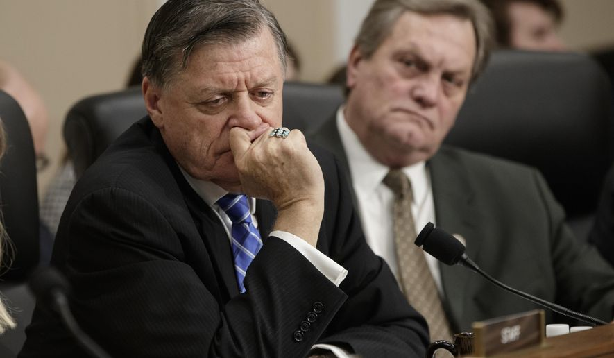 Rep. Tom Cole, R-Okla., left, and Rep. Mike Simpson, R-Idaho, listen to statements by the minority as Health and Human Services Secretary Tom Price, a doctor and former congressman, testified on Capitol Hill in Washington, Wednesday, March 29, 2017, before a House Appropriations subcommittee to outline the Trump Administration's proposals to trim the HHS budget. (AP Photo/J. Scott Applewhite) ** FILE **