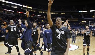 FILE - In this Dec. 18, 2016, file photo, Gonzaga guard Jordan Mathews (4) waves to fans as the team leaves the court after defeating Tennessee 86-76 in an NCAA college basketball game in Nashville, Tenn. Mathews got tired of losing at California and made the tough decision to transfer. After sitting out a season, it seems the decision has paid off with a trip to the Final Four with Gonzaga.(AP Photo/Mark Humphrey, File)