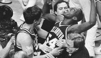 FILE - In this April 1, 1985 file photo, Villanova's Ed Pinckney (54) yells out as he is surrounded by teammates after the Wildcats defeated Georgetown for the national championship in the Final Four of the NCAA college basketball tournament in Lexington, Ky. (AP Photo/Gary Landers, File)