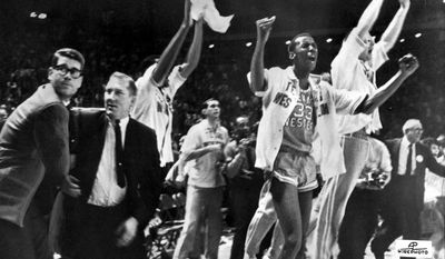 FILE - In this March 19, 1966, file photo, Texas Western College head basketball coach Don Haskins, second from left, and players celebrate after winning the 1966 NCAA college basketball championship against Kentucky in College Park, Md.  (AP Photo/File)