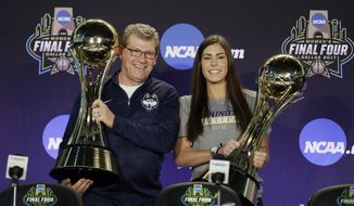 Connecticut head coach Geno Auriemma, left, and Washington's Kelsey Plum, right, hold their respective trophies after they were named the Associated Press Women's Basketball Coach of the Year and AP Women's Player of the Year at the women's NCAA Final Four college basketball tournament, Thursday, March 30, 2017, in Dallas. (AP Photo/Tony Gutierrez)