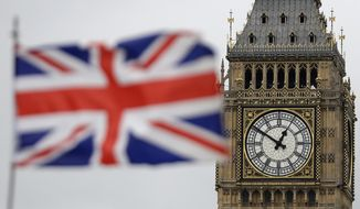 """British Union flag waves in front of the Elizabeth Tower at Houses of Parliament containing the bell know as """"Big Ben"""" in central London, Wednesday, March 29, 2017. (AP Photo/Matt Dunham) ** FILE **"""