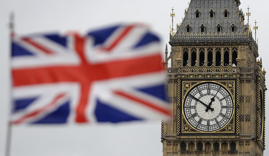 "British Union flag waves in front of the Elizabeth Tower at Houses of Parliament containing the bell know as ""Big Ben"" in central London, Wednesday, March 29, 2017. (AP Photo/Matt Dunham) ** FILE **"