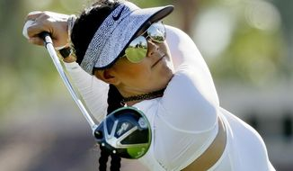 Michelle Wie, the golf course reflected in her sunglasses, watches her tee shot on the third hole during the first round of the LPGA Tour ANA Inspiration golf tournament at Mission Hills Country Club Thursday, March 30, 2017 in Rancho Mirage, Calif. (AP Photo/Chris Carlson)