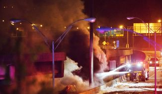 Smoke billows from a section of an overpass that collapsed from a large fire on Interstate 85 in Atlanta, Thursday, March 30, 2017. Witnesses say troopers were telling cars to turn around on the bridge because they were concerned about its integrity. Minutes later, the bridge collapsed. (AP Photo/David Goldman)