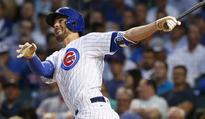 FILE - In this Aug. 31, 2016, file photo, Chicago Cubs' Kris Bryant follows through on a solo home run during the first inning of a baseball game against the Pittsburgh Pirates, in Chicago. Terms like launch angle and exit velocity are creeping into the baseball lexicon, and it's not just number crunchers jumping on board. The successes of Josh Donaldson, Jose Bautista and Bryant are changing the way hitters and coaches think about the swing. (AP Photo/Nam Y. Huh, File)