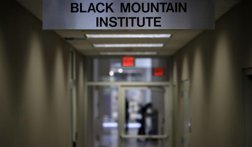 A sign for the Black Mountain Institute hangs in a hallway in a building at the University of Las Vegas, Nevada, Wednesday, March 29, 2017, in Las Vegas. The the Black Mountain Institute has purchased The Believer, a highly praised and proudly off-beat literary magazine founded in 2003. (AP Photo/John Locher)