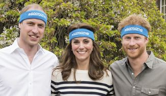 Undated handout  photo of Britain's  Prince William, left, Kate Duchess of Cambridge and Prince Harry wearing charity headbands  issued by The Royal Foundation of the Duke and Duchess of Cambridge and Price Harry. The three royals  are spearheading a campaign to encourage people to talk openly about mental health issues. The young royals released 10 films Thursday as part of their Heads Together campaign to change the national conversation on mental health.  (The Royal Foundation of the Duke and Duchess of Cambridge and Price Harry via AP)