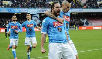 FILE- In this Sunday, Feb. 7, 2016 file photo, Napoli's Gonzalo Higuain, front left, celebrates with teammate Marek Hamsik after scoring during a Serie A soccer match between Napoli and Carpi, at the San Paolo stadium in Naples, Italy. Higuain is prepared for a fiery reception when he returns to Napoli for the first time since his move to bitter rival Juventus. (AP Photo/Salvatore Laporta, File)