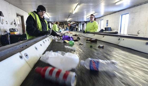 Material sorters work at TC Recycling in Mars, Pa., on Monday, March 13, 2017. (Sidney Davis/Pittsburgh Tribune-Review via AP) ** FILE **