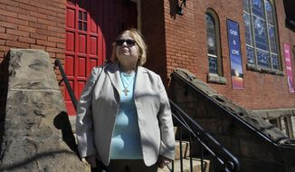 "FOR RELEASE SATURDAY, APRIL 1, 2017, AT 3:01 A.M. EDT.- Nancy Hoover, vicar at Grace Lutheran Church in the West End section of Johnstown, Pa., is shown outside the church, Wed., March 22, 2017. She is doing her part to battle the region's heroin epidemic. Hoover said she was stunned three years ago when she was asked by a young woman to speak at a funeral service for her brother, who had died of a heroin overdose. ""They were from a good, middle-class family,"" Hoover said. (Todd Berkey/Tribune-Democrat via AP)"