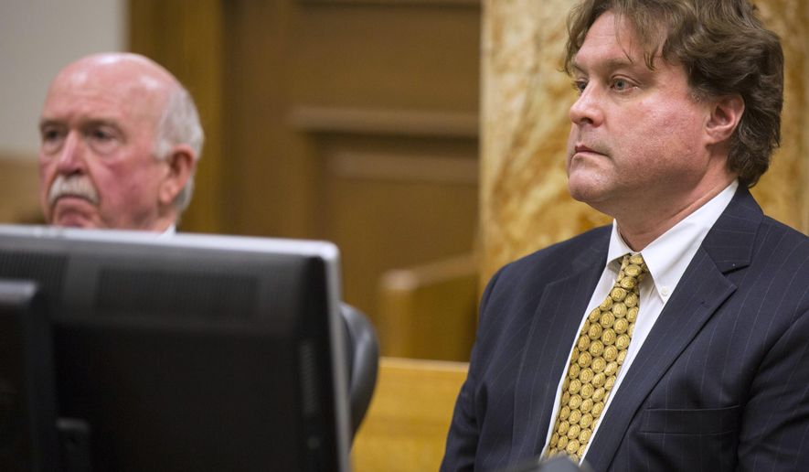 FILE - In this Jan. 9, 2017 file photo, Texas businessman Robert Rhodes, right, sits with his attorney, Joseph Cahill, as he enters a plea of guilty in a jackpot rigging scandal in Polk County District Court in Des Moines, Iowa. Rhodes has reached a plea agreement to testify in trials in Iowa and Wisconsin about how his long-time best friend, Eddie Tipton, a former lottery computer technician, created computer code that enabled him to predict winning numbers. (Rodney White/The Des Moines Register via AP, File)