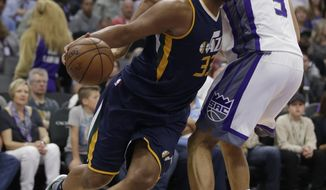 Utah Jazz center Boris Diaw, left, drives past Sacramento Kings forward Skal Labissiere during the first half of an NBA basketball game, Wednesday, March 29, 2017, in Sacramento, Calif. (AP Photo/Rich Pedroncelli)