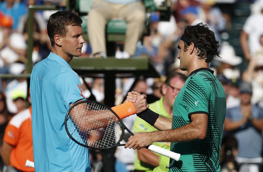 Roger Federer, right, of Switzerland, and Tomas Berdych, of the Czech Republic, shake hands after Federer defeated Berdych 6-2, 3-6, 7-6 (6) during a tennis match at the Miami Open, Thursday, March 30, 2017 in Key Biscayne, Fla. (AP Photo/Wilfredo Lee)